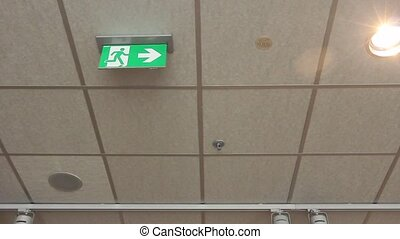 Green emergency exit sign. - Standard international symbol...