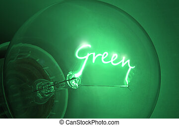 Green energy. - Close up of green light bulb with the...
