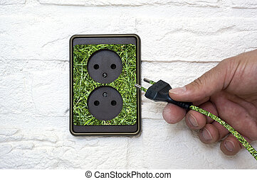 Green energy coming out of an outlet