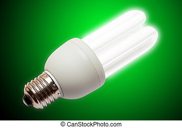 Green energy - Concept of lighten light bulb on green...