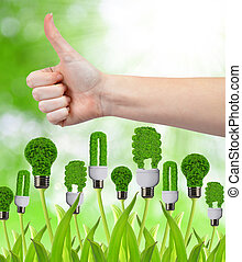 Green energy concept - Hand with thumb up and eco energy...