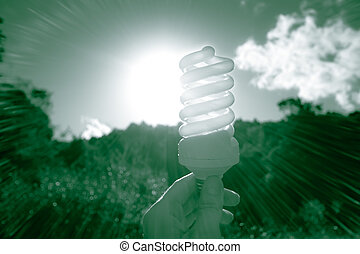 Green Energy concept with energy saving light bulb