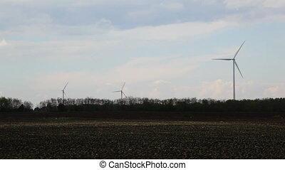 Green energy on empty field, tilt to sky