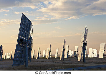 Green Energy Solar Mirror Panels at Sunset or Sunrise - A...