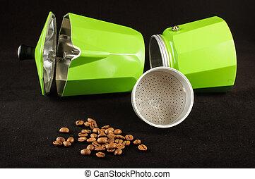 Green espresso coffee maker lying o