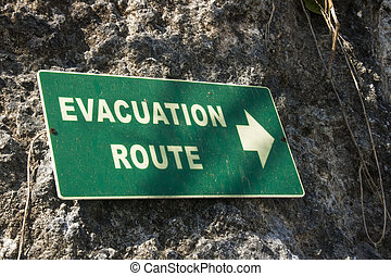 green evacuation route sign photo