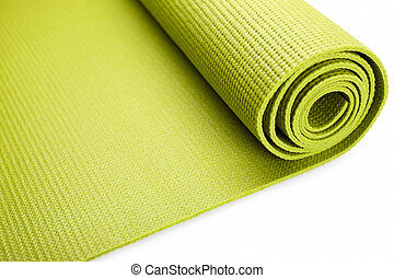 Green exercise mat isolated on white background.