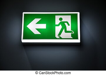 Green Exit Sign Isolated In Dark