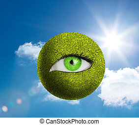 Green eye in a green globe with the sky in background