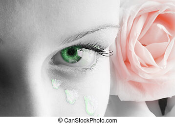 beautiful close up of a green eye and a pink rose and petals painted as tears