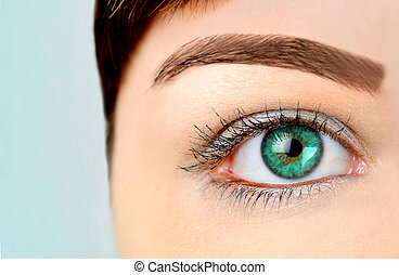 Green eye - Woman with green eye on blue background