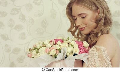 Green-eyed blonde delighted with the the beautiful bouquet...