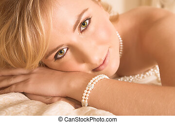 Green-eyed bride - Young bride with large green eyes resting...