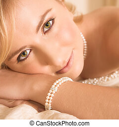 Young bride with large green eyes resting on her hands