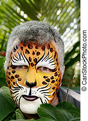 Green Eyed Leopard Man - A man with his face painted to look...