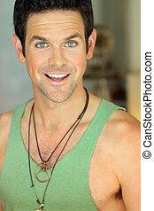 Green eyed man smiling