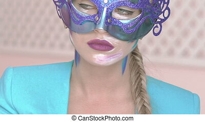 Green eyes gazing of the mysterious girl in venetian mask with winter art makeup
