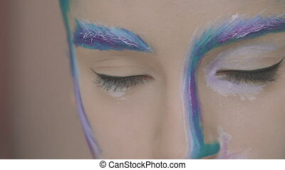 Green eyes look of the mysterious girl with winter art make up