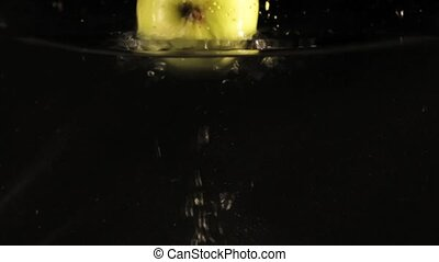 Green Fallen Apples into Water Slow