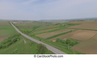 green field with road. drone video.