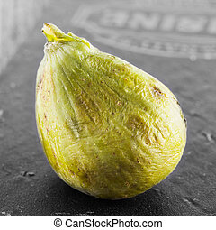 Green fig over black and white background