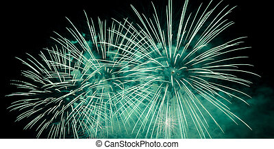 Green fireworks in the night sky