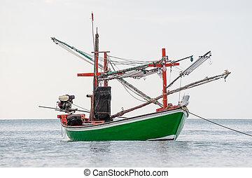 Green fishing boat thai on the sea