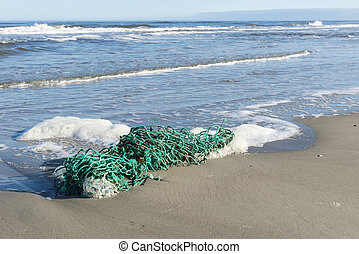 Green fishing net on the beach