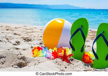 green flip flops and beach ball