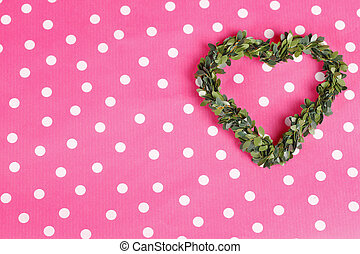 Green floral heart on pink ground
