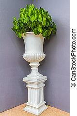 Green flowers in flower vintage pot