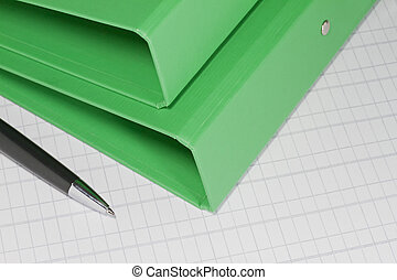 Green folders with pen