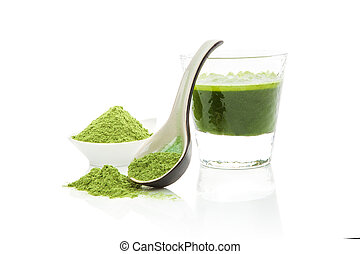 Green food supplements. - Wheat grass powder on spoon, green...