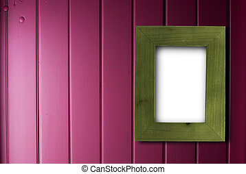 green frame over a purple wooden background with copy space on the left