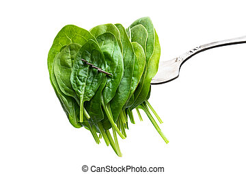 Green fresh spinach on vintage fork isolated on white