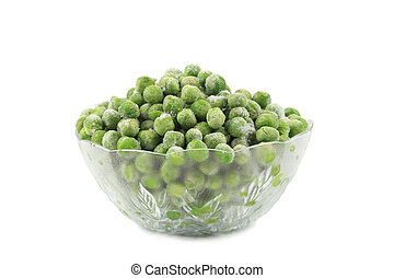 Green frozen peas in a glass dish.
