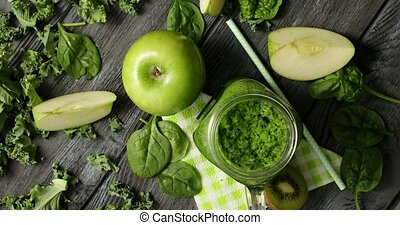 Green fruits and salad in composition - From above shot of...