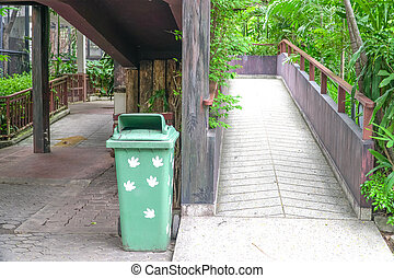 Green Garbage Bin, Plastic Container, near walk way In The Zoo Park
