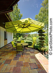 Green garden furniture with sunshade