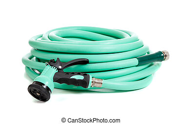 Green garden hose on a white background - a green rubber...