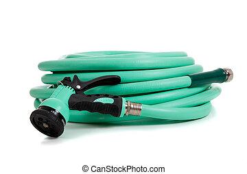 Green garden hose with spray nozzle