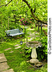 Green garden - Path of stepping stones leading into lush...