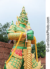 green giant standing statue at temple wall