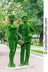 "Green giants family on Tverskoy Boulevard. Festival ""Moscow Seasons"". Moscow"