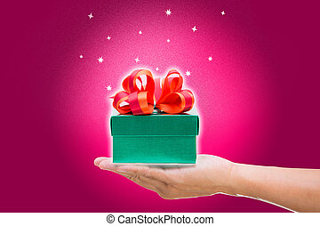 Green gift box on hand