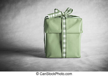 Green Gift Box Tied with Bow - A solitary, vintage styled...