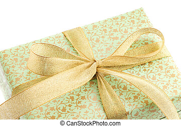 green gift box with gold ribbon