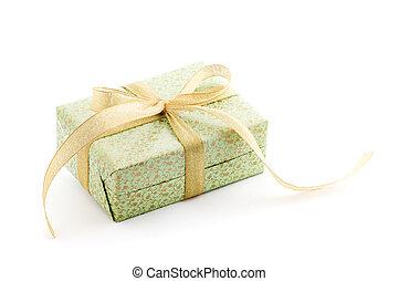 green gift box with gold ribbon