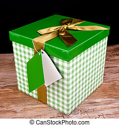 Green gift box with golden bow