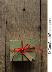 Green Gift Box with Red Ribbon and Vintage Style Blank Tag